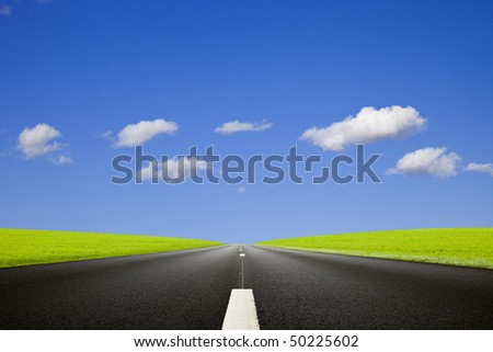 Black roadway against a deep blue sky