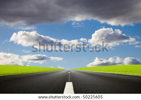 Black roadway against an amazing cloudy sky