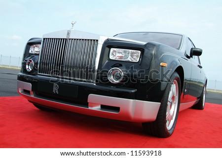 Black Rolls Royce Phantom on a red carpet - stock photo