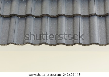 black roof tiles on new house - stock photo