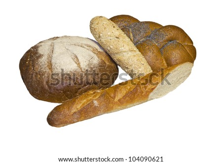 Black round bread, rich wattled roll with a poppy and two baguettes, isolated on a white background.