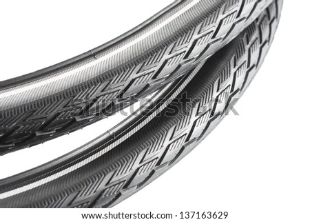 black rubber bicycle tyre on white background - stock photo