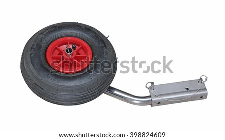 Black rubber inflatable and red plastic wheel with stainless boat transom bracket isolated on white - stock photo