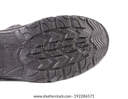 Black rubber shoe sole. Isolated on a white background. - stock photo