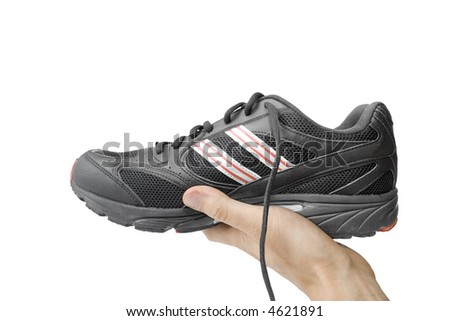 black running shoe in the hand isolated on white - stock photo