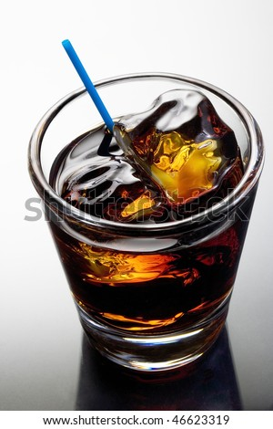 Black Russian mixed drink on a grey background with reflection - stock photo