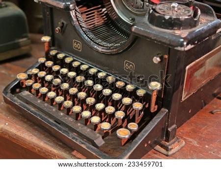black rusty typewriter with white keys - stock photo
