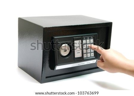 black safe with code lock, hand about to press the code - stock photo