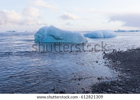 Black sand beach and Ice breaking from iceberg, Iceland winter season natural landscape background