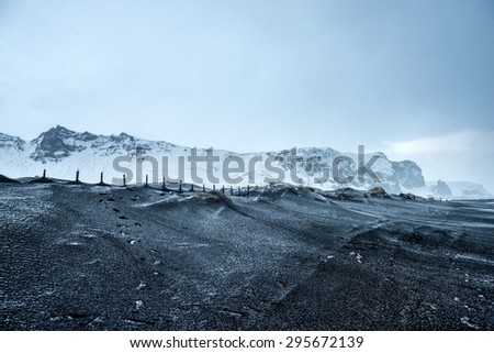 black sand beach in Vik, Iceland (famous game of thrones TV series  filming locations) - stock photo
