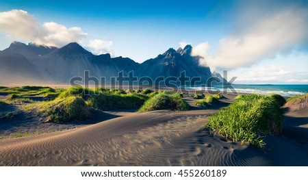 Black sand dunes on the Stokksnes headland on southeastern Icelandic coast. Colorful evening landscape in the Iceland, Europe. Artistic style post processed photo.