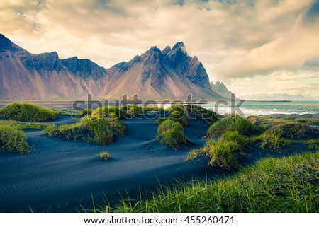 Black sand dunes on the Stokksnes headland on southeastern Icelandic coast. Colorful evening landscape in the Iceland, Europe. Retro style filtered.