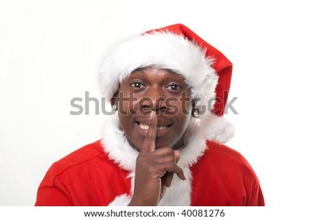 black santa claus telling to keep it quiet - stock photo