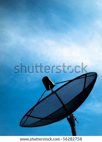 Black Satellite information signals are sent to space - stock photo