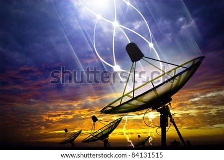 Black satellite under storm clouds - stock photo