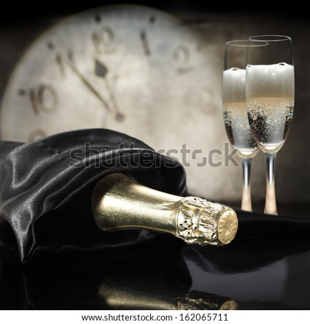 black satin and champagne  - stock photo