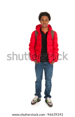 Black schoolboy in red coat wit backpack - stock photo