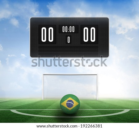 Black scoreboard with no score and football against football pitch under blue sky - stock photo