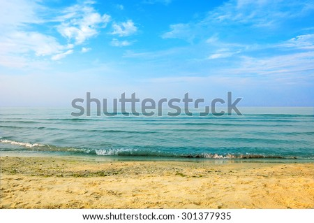 Black sea beach blue sky sand sun daylight - stock photo