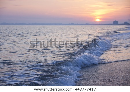 Black sea near Yevpatoriya in Crimea. Wave of water at sunset