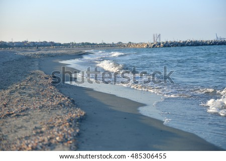 Black Sea shore with smooth wave in the evening as nature travel background