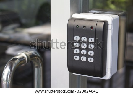 black security door have a number bottom and led light red yellow green - stock photo