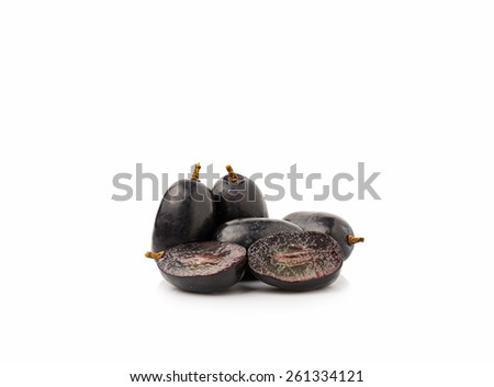 Black seedless grapes on white background