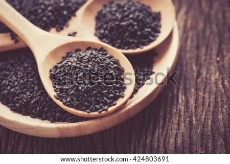 black Sesame close up shot  on wood background - stock photo