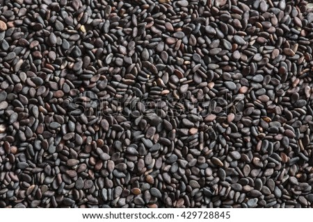 Black sesame seeds. A lot of healthy black sesame seeds. Top view. - stock photo