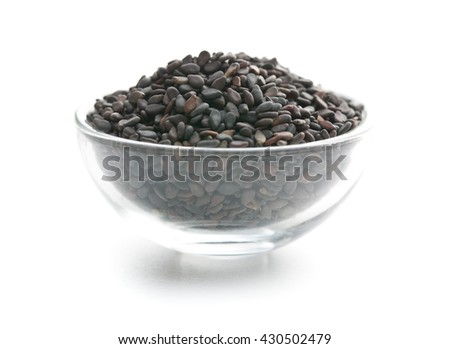 Black sesame seeds. Healthy sesame seeds in bowl  isolated on white background. - stock photo
