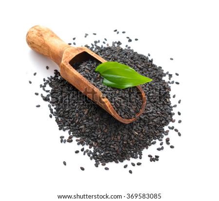 Black sesame seeds. Isolated on white background. - stock photo