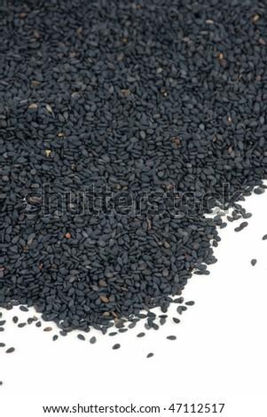 Black sesame seeds on white background - stock photo