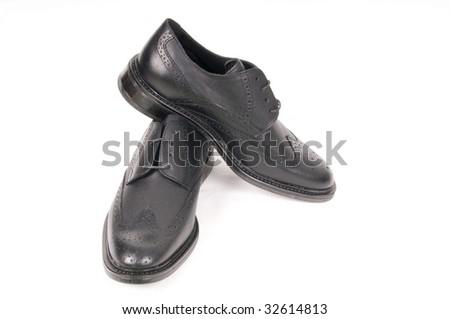 black shiny man's shoe -similar image- - stock photo