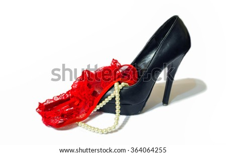 Black shoe, red panties and pearls on white background  - stock photo