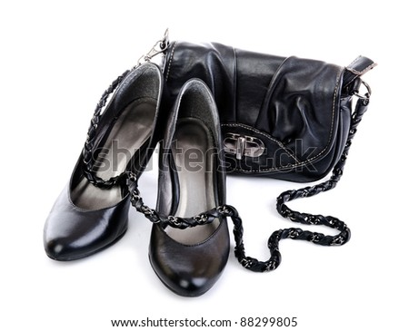 Black shoes and purse isolated on white