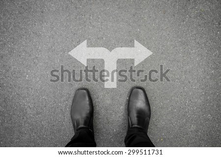 Black shoes has decision to make at the cross road - stock photo