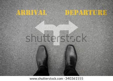 Black shoes has decision to make at the cross road - arrival or departure - stock photo