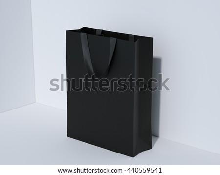Black shopping bag in bright studio. 3d rendering - stock photo