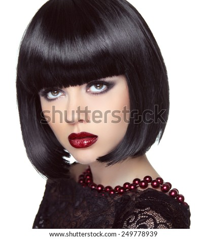 Black short bob hairstyle. Fashion brunette girl model with makeup looking up. Haircut. Jewelry. Smoky eyes. Vogue style lady.  - stock photo
