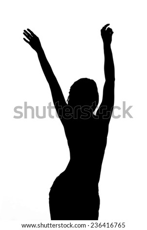 Black silhouette of happy dancing woman isolated on white background