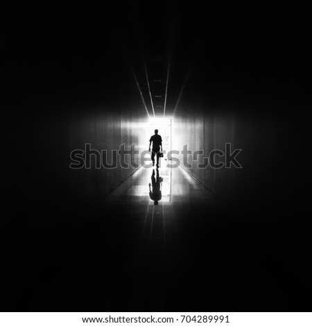 Black silhouette of person walking