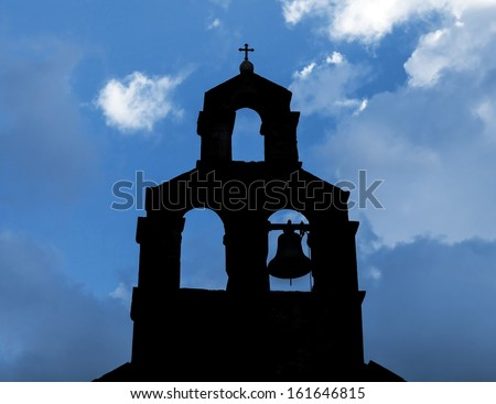 Black silhouette of Serbian Orthodox Church with bell in Petrovac, Montenegro - stock photo