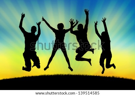 black silhouettes of four happy people jumping in joy on the grass on a sunset sky background