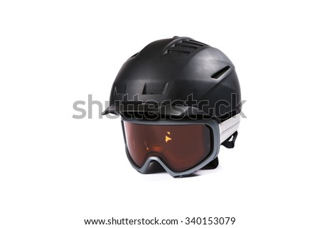 Black ski and snowboard helmet and glasses on white background