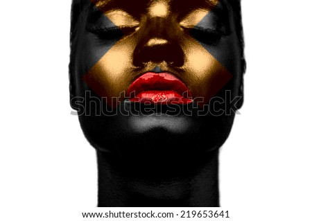 Black skin, red lips and gold cross on face of fashion beauty model - stock photo