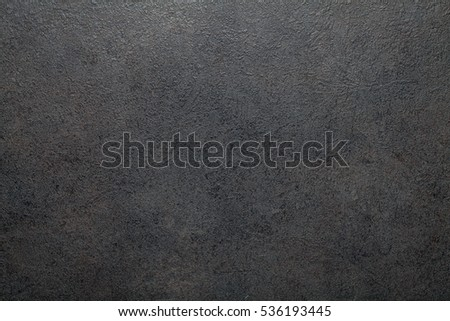 Black slate background or textured stony table