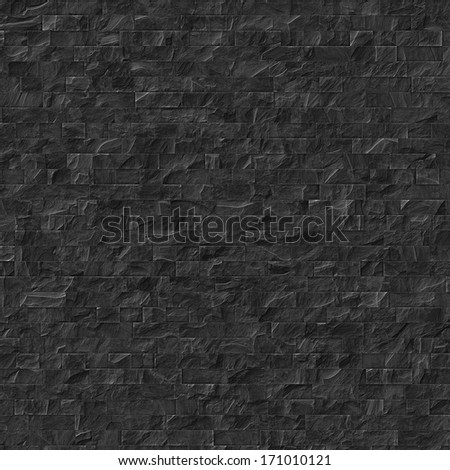Black slate-tiled wall