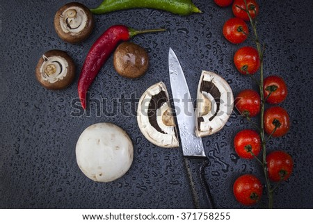 black slate with cucumbers, peppers and tomatoes cut