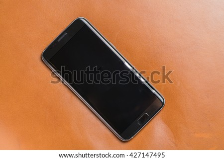 Black smartphone with silver edges  - stock photo