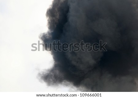 Black Smoke from a Gasoline and Dynamite Explosion (smoke texture with white cloud contrast) - stock photo